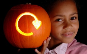 Girl with carved pumpkin