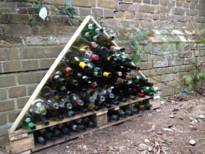 Bug hotel made from glass bottles and pallets